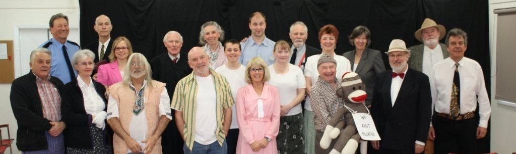 Cast of Inherit the Wind, back row, left to right: Cec Ashley, Victor Anthony, Nadine Mourao, Jamie Lawrence, Joyce Ashley, Sam Hooton, Alex Dewar, Alisa Perry, Garry Davey, Jean Wyenberg, Donna Deacon, Mark Smith. Front row: Eric Andersen, Catherine Andersen, Lawrence Spero, Peter Dzierzawa, Lesley Hazeldine, John Hague, Konrad Mauch, Charlie Cheffins.